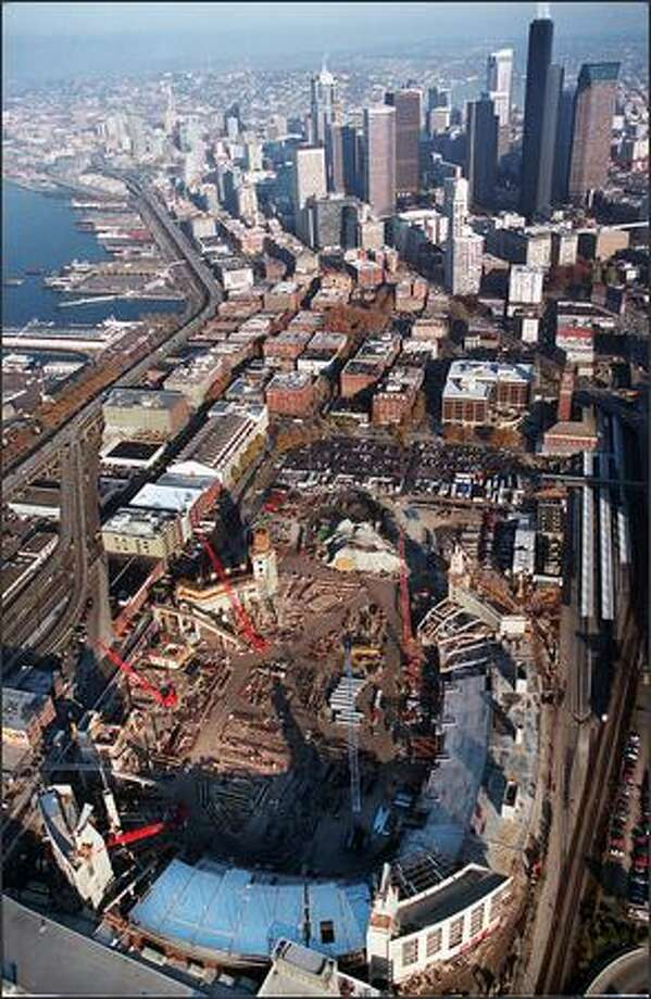 A view of the Seahawks stadium under construction. While Qwest Field has contributed major sales tax revenue, other predicted benefits have been slow to materialize. Photo: / P-I File
