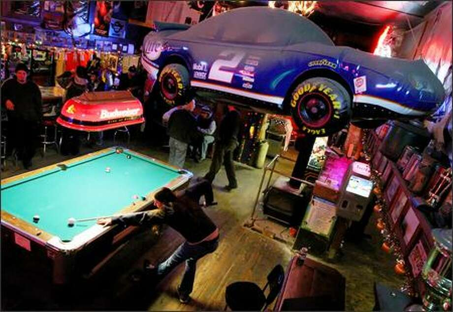 """Roni Brook works the pool table at Bethel Saloon in Port Orchard recently. The owner of the saloon, Dan Stewart, and many patrons support building a NASCAR track in Kitsap County. But state Sen. Margarita Prentice, D-Renton, sees no state need """"to invest in a white elephant."""" Photo: Joshua Trujillo/Seattle Post-Intelligencer"""