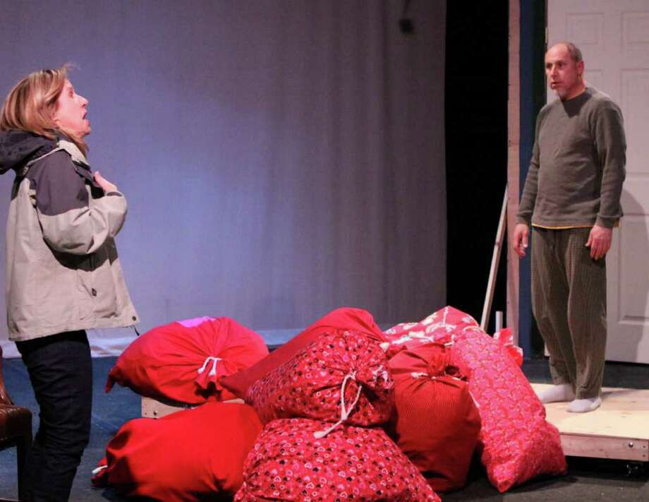 """Actors act out a scene from """"Almost, Maine."""" Photo: Contributed Photo / Darien News"""