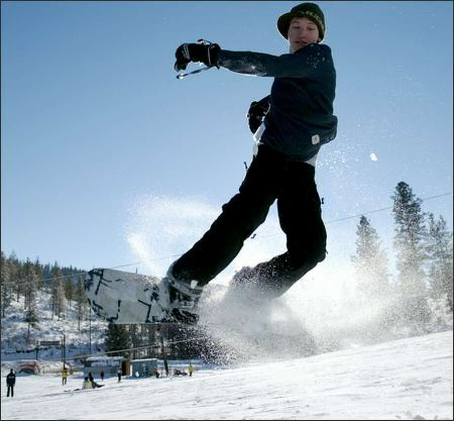 Mark Peterson, 14, of Chelan, performs a jump at Echo Valley Ski Aread near Chelan. Photo: Joshua Trujillo/Seattle Post-Intelligencer