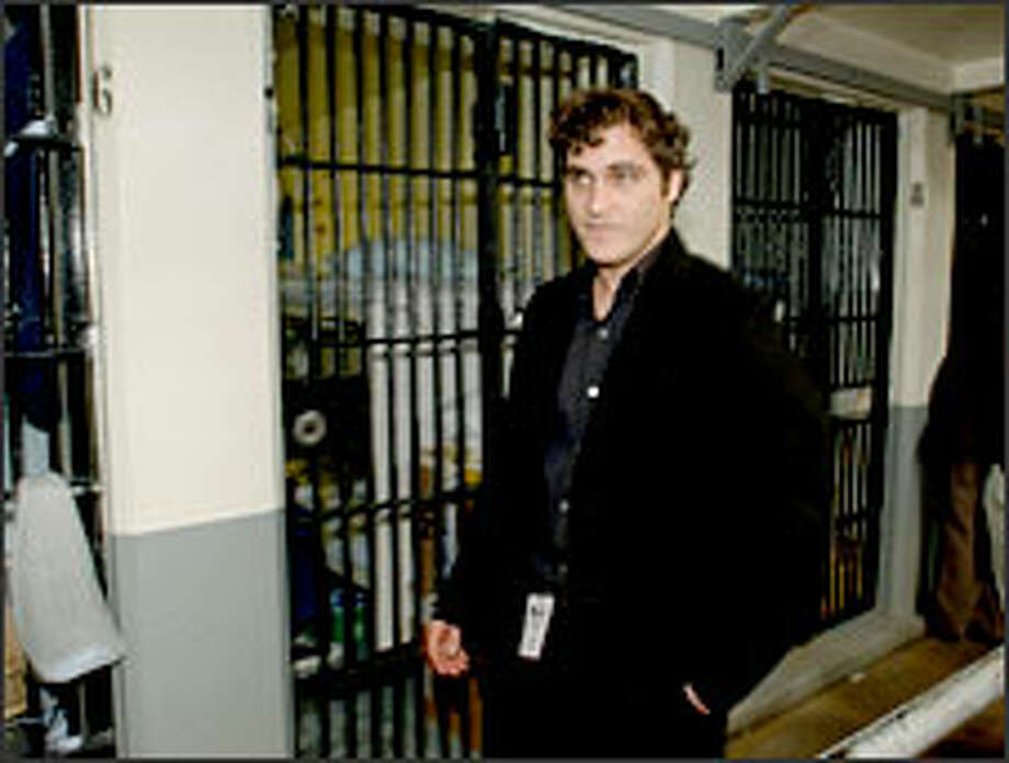 """Stop the presses! At last a celeb shown in prison on a brief visit instead of a lengthy incarceration! Joaquin Phoenix passes through the cellblock at Folsom Prison in California for a Tuesday screening of his flick, """"Walk the Line,"""" and performance of a couple of Johnny Cash numbers before an inmate audience."""