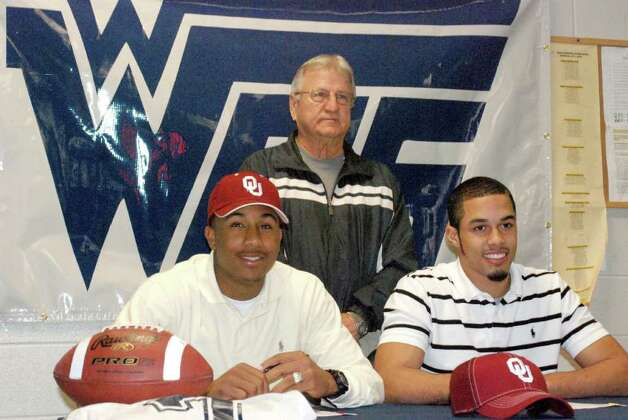 West Orange-Stark coach Dan Hooks with Oklahoma signees Trey Franks, left, and James Haynes this past February. photo provided by West Orange Cove I.S.D. Photo: Courtesy West Orange Cove CISD