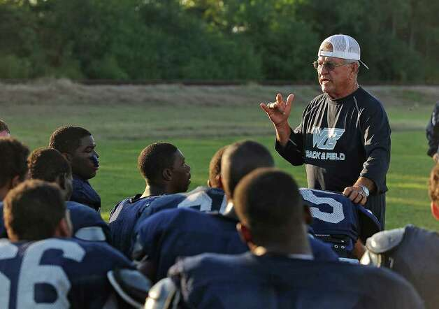 With recent tragedy stricken the West Orange-Stark team, Coach Dan Hooks said his team has a lot to fight for right now and that their attitudes to win will be unstoppable. Dan Hooks addresses his team during practice on Wednesday. Hooks is the longest tenured high school football coach in the area and simultaneously posses the most wins. Hooks has coached football for 48 years and the current season is his 30th for the Mustangs.   Guiseppe Barranco/The Enterprise / Beaumont