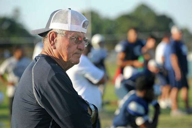 With recent tragedy stricken the West Orange-Stark team, Coach Dan Hooks said his team has a lot to fight for right now and that their attitudes to win will be unstoppable. Dan Hooks watches over his team during practice on Wednesday. Hooks is the longest tenured high school football coach in the area and simultaneously posses the most wins. Hooks has coached football for 48 years and the current season is his 30th for the Mustangs.   Guiseppe Barranco/The Enterprise / Beaumont