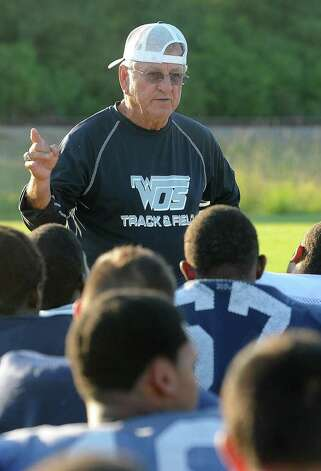 With recent tragedy stricken the West Orange-Stark team, Coach Dan Hooks said his team has a lot to fight for right now and that their attitudes to win will be unstoppable. Dan Hooks addresses his team during practice on Wednesday. Hooks is the longest tenured high school football coach in the area and simultaneously posses the most wins. Hooks has coached football for 48 years and the current season will be his 30th for the Mustangs.   Guiseppe Barranco/The Enterprise / Beaumont