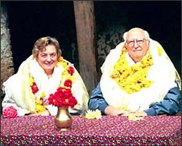 Suzanne Cluett and Bill Gates Sr. were welcomed in October 1999 with flower leis and kata scarves to Junbasi, Nepal. Photo: Family Photo / FAMILY HANDOUT PHOTO