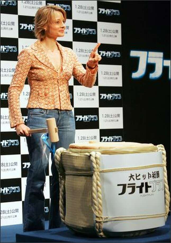 U.S. press conferences can be such a snore. It's a different world in Japan, as Jodie Foster learns on a promo tour when she is called upon to wield a wood mallet and smash open a container of sake. Kampai! Photo: AP