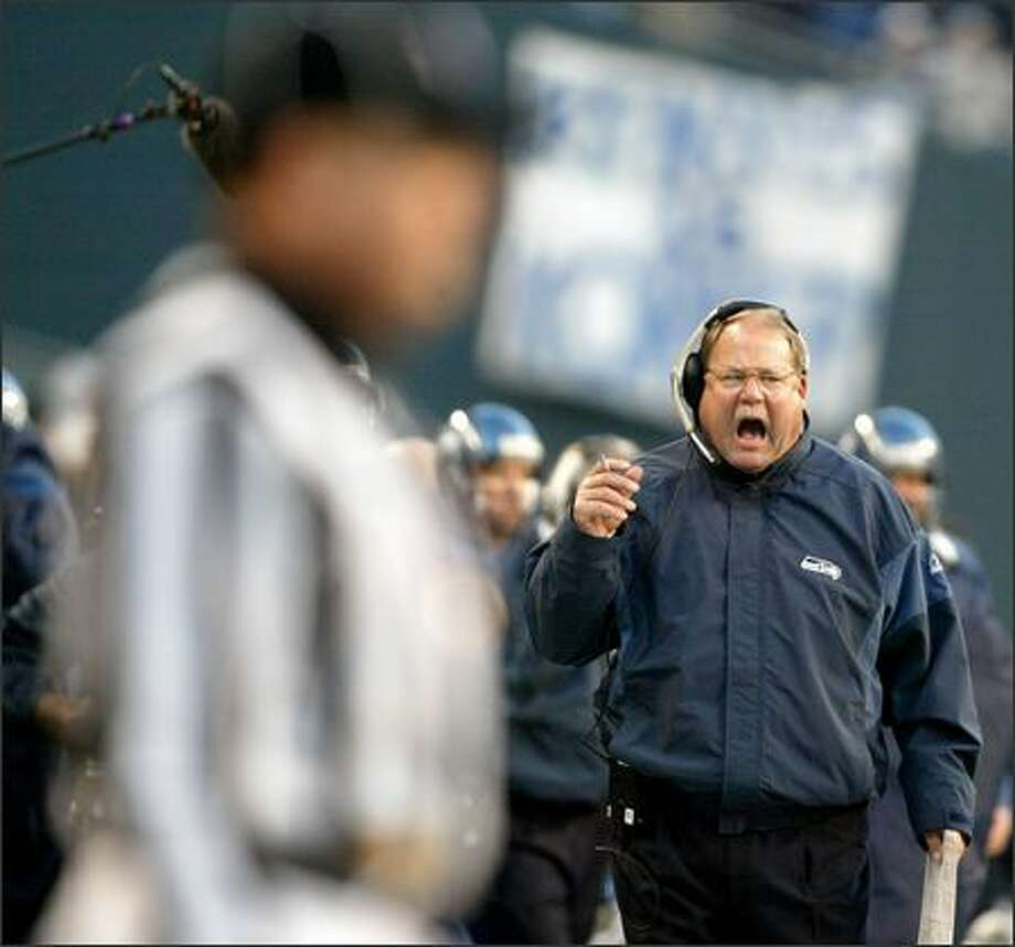 """I'm an emotional coach,"" said Mike Holmgren, shown chewing out an official. Photo: Scott Eklund/Seattle Post-Intelligencer"