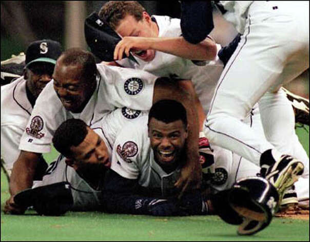 1995: Ken Griffey Jr.'s smile said it all after his run clinched the Mariners' AL Division Series win against the legendary Yankees in the Kingdome. Many consider it the city's happiest sports moment. Photo: Robin Layton/Seattle Post-Intelligencer