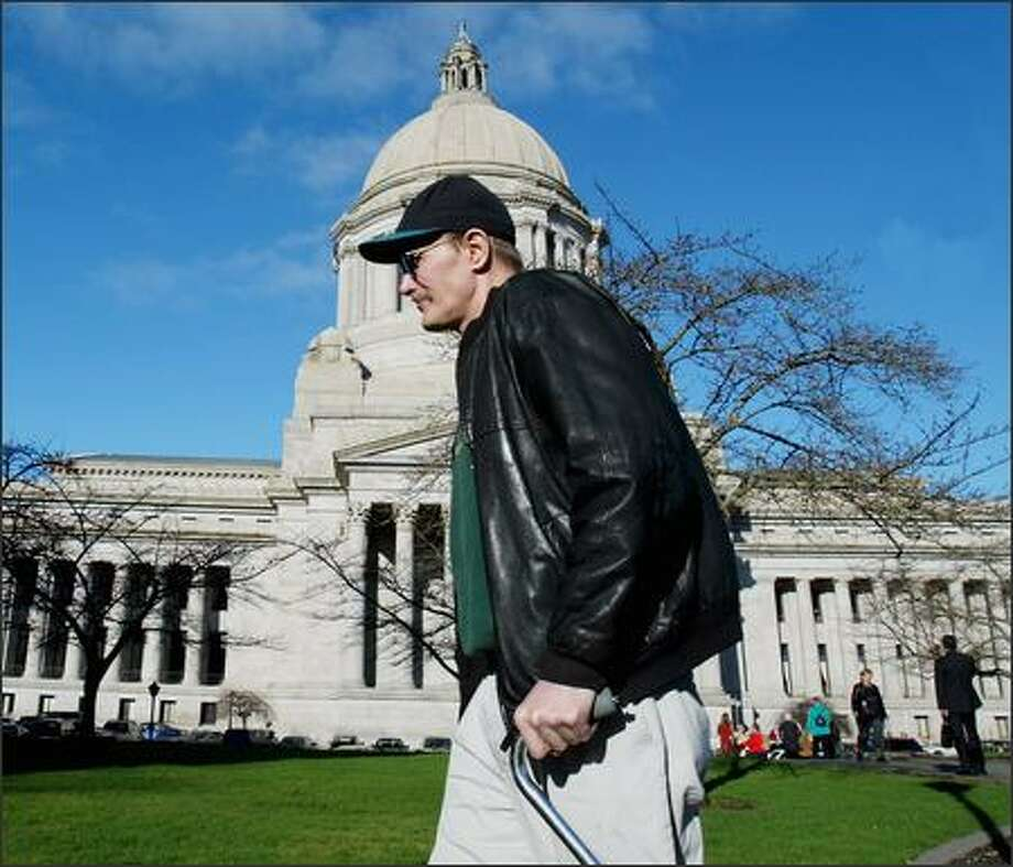 Dave Gallaher of North Seattle, shown in Olympia Monday, says the program has saved him money. He says his doctor switched him to all generic medicines, and his pharmacy is not going to charge him. Photo: PAUL JOSEPH BROWN/P-I