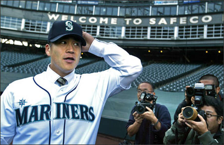 Catcher Kenji Johjima, who signed a three-year deal with the Mariners that will pay him $16.5 million, meets with the media Tuesday at Safeco Field. Photo: Scott Eklund/Seattle Post-Intelligencer / Seattle Post-Intelligencer