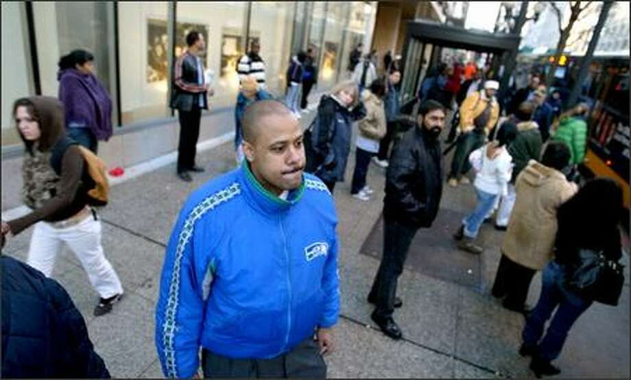 Andre Burshain sports Seahawks colors Tuesday on Third Avenue, but not many others were. Downtown was largely devoid of team paraphernalia. Photo: Scott Eklund/Seattle Post-Intelligencer
