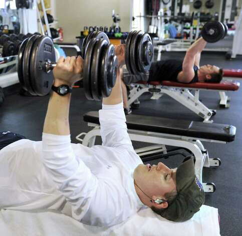 Eric Bickler, 35, left, Harrison Wolnick, 22, lift weights at the Ridgefield Fitness Club. Photo taken Friday, March 18, 2011. Photo: Carol Kaliff / The News-Times