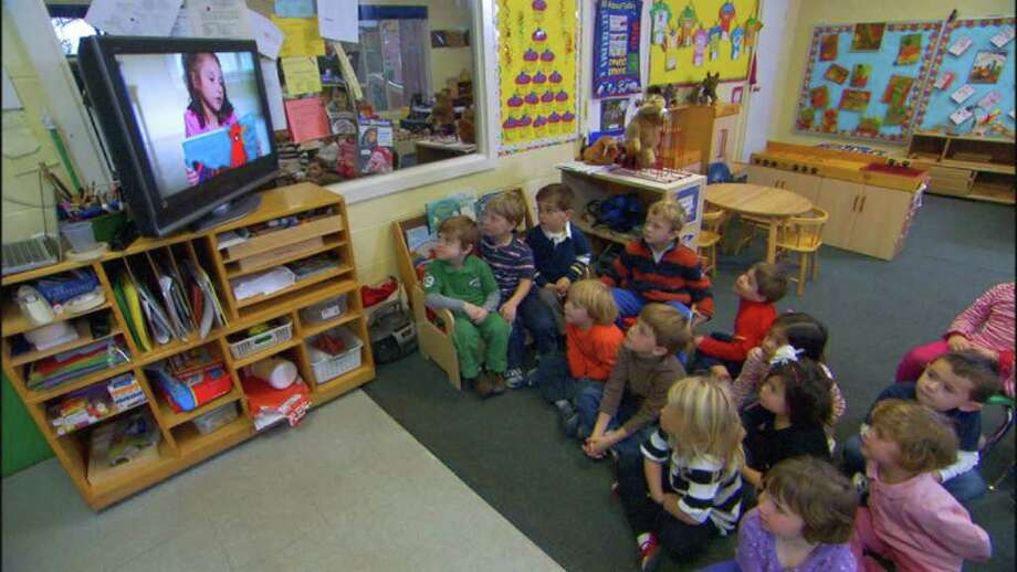 "Students at First Presbyterian Church Nursery School in Greenwich watch FBCNS alum Sela Turkel in ""Can I Read To You?"" The DVD, produced by Stamford-based Ten Mayflower Productions, is designed to promote an appreciation for literacy and books among preschool-age children. Photo: Contributed Photo / Connecticut Post Contributed"