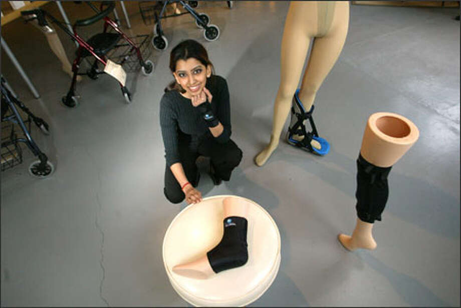 Priya Puri manages OrthoSys, owned by her father, Vic. Among the products they sell: compression stockings, night splints, knee skins and ankle skins. Photo: /Seattle Post-Intelligencer