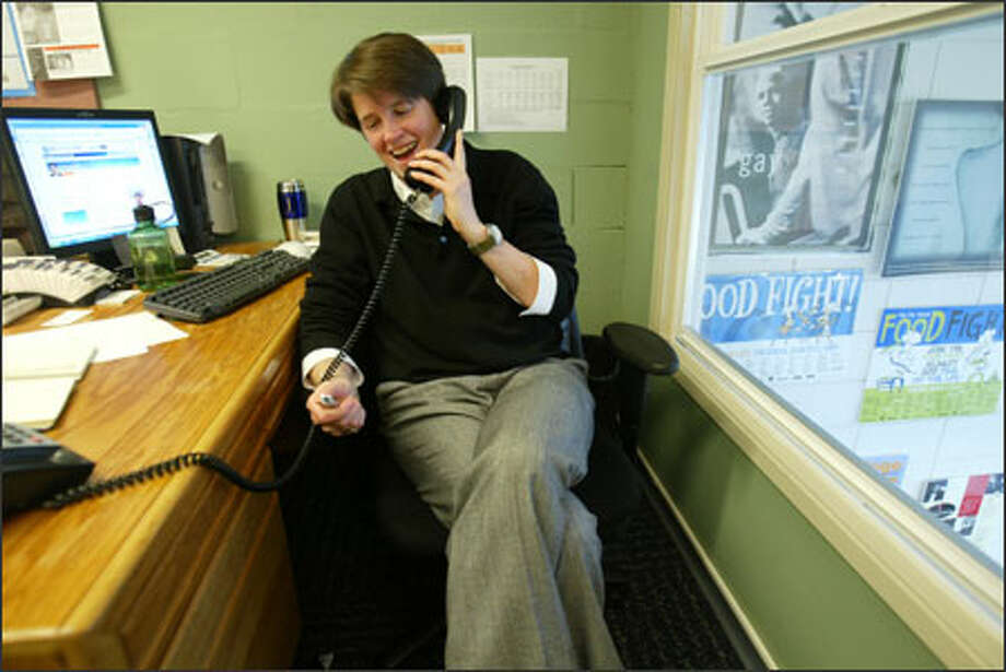 Sally Clark takes one of many congratulatory phone calls Friday after it was announced she had been selected for the council. Photo: Paul Joseph Brown/Seattle Post-Intelligencer
