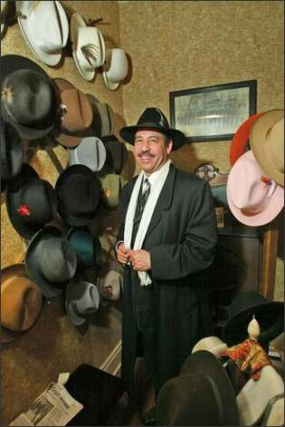 "Circuit Court Judge Craig Strong in the ""hat room"" at his 6,000-square-foot mansion in Indian Village, Detroit. Photo: GRANT M. HALLER/P-I"