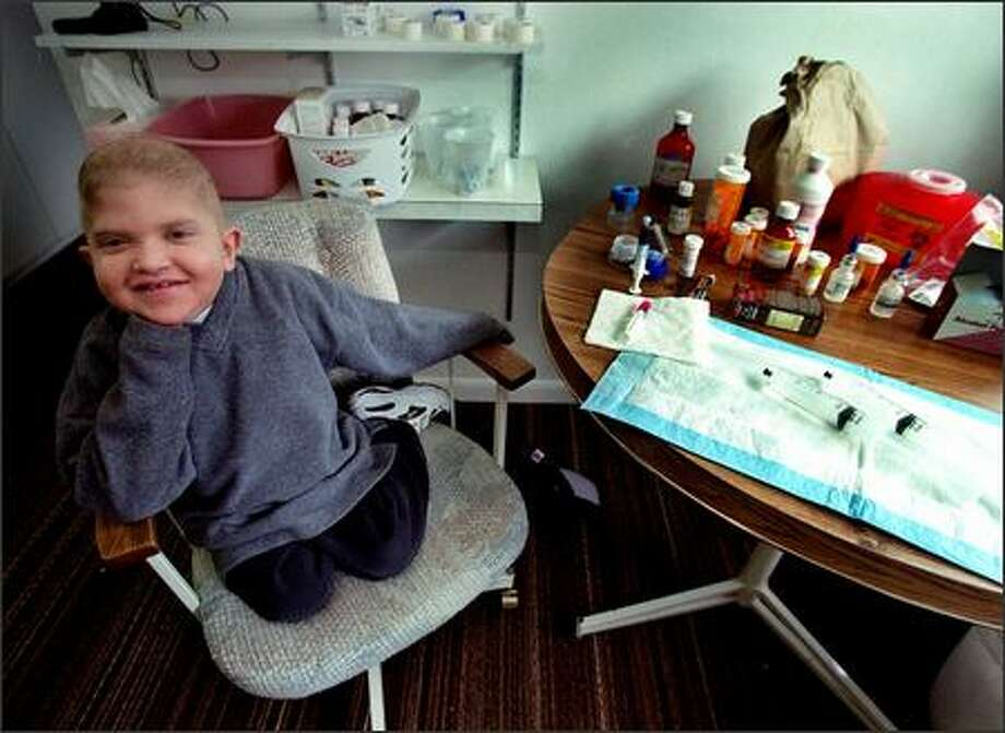 Perry Cerquone, 7, waits for his mom to prepare his intravenous magnesium as part of his treatment for leukemia in this photo from 2002. Photo: RENEE C. BYER/P-I