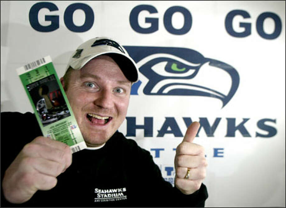 Jubilant Seahawks fan Peter Richards shows off his ticket to the Super Bowl Photo: Jim Bryant/Seattle Post-Intelligencer / SEATTLE POST-INTELLIGENCERF