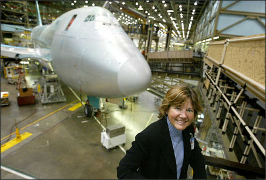 "Corky Townsend, standing in front of the nose of a 747-400 freighter, looks forward to the day when her ""baby,"" the 747-8, goes into service in 2009. Photo: Paul Joseph Brown/Seattle Post-Intelligencer"