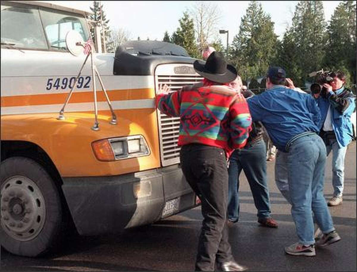 Fans try to stop a moving truck loaded with weightroom equipment from leaving the team's Kirkland facility in 1996.