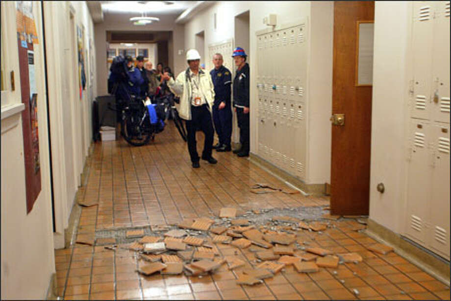 Buckled tiles litter the second-floor hallway of Thomson Hall on the UW campus Thursday. Photo: Karen Ducey/Seattle Post-Intelligencer / Karen Ducey