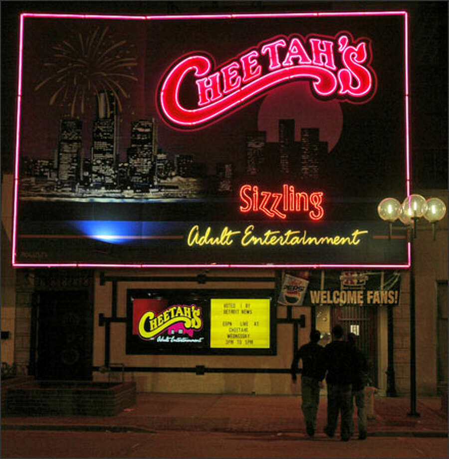 Three men head into Cheetah's in Windsor, Ontario -- for the kind of entertainment you can't find in Seattle. Photo: Grant M. Haller/Seattle Post-Intelligencer