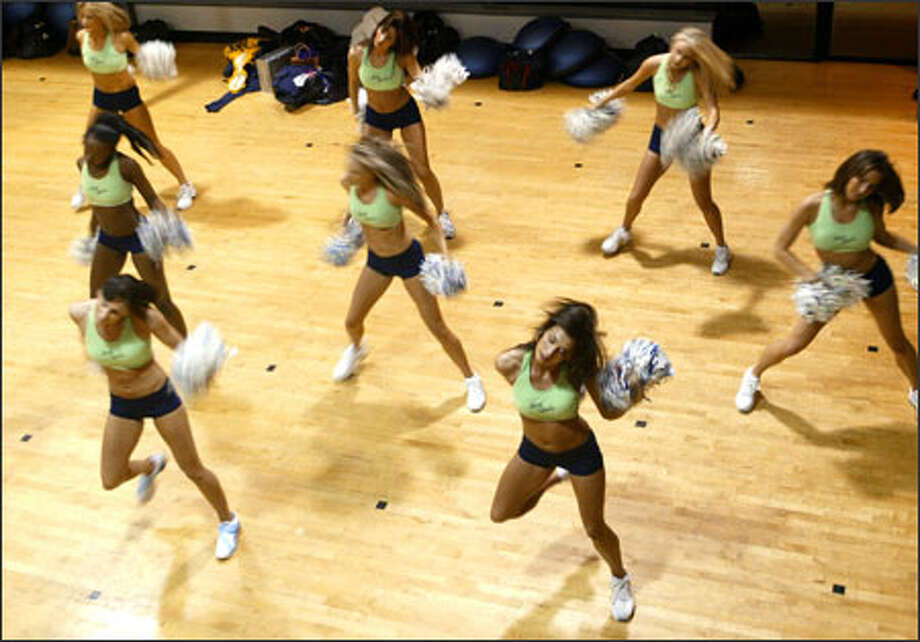 Carly Cozine-Hansen, front right, practices with the Sea Gals at a Bellevue gym early this week. The Sea Gals will perform at the Super Bowl on Sunday. Photo: Meryl Schenker/Seattle Post-Intelligencer