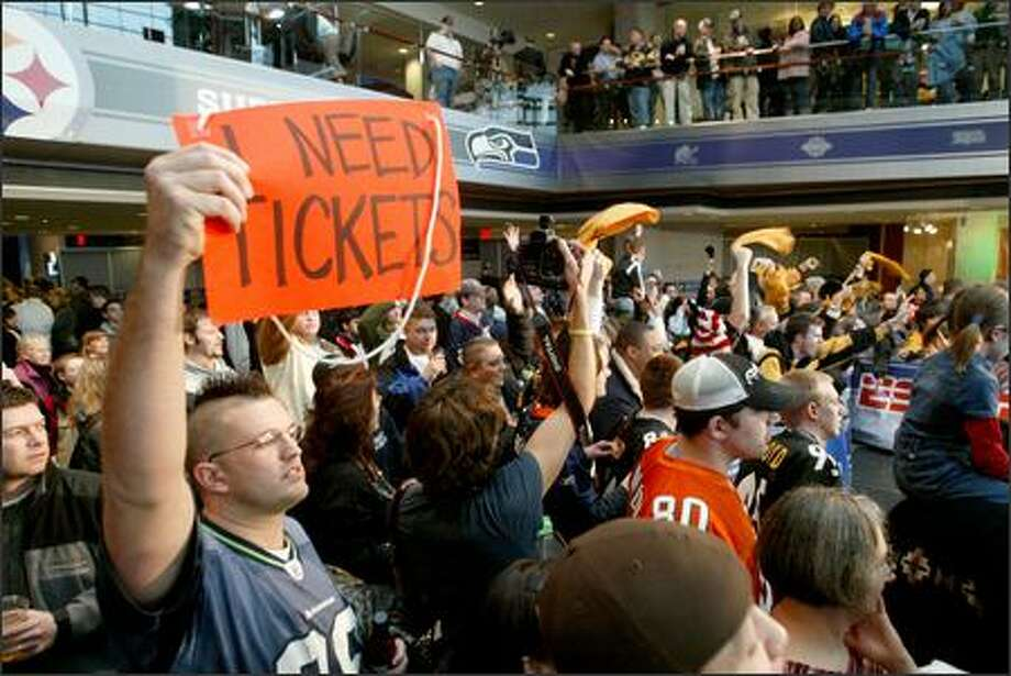 Morgan Davidson of Seattle seeks game tickets -- and is willing to go as high as $3,000 -- at the Super Bowl media center in Detroit, where Steelers fans abound. Photo: Scott Eklund/Seattle Post-Intelligencer