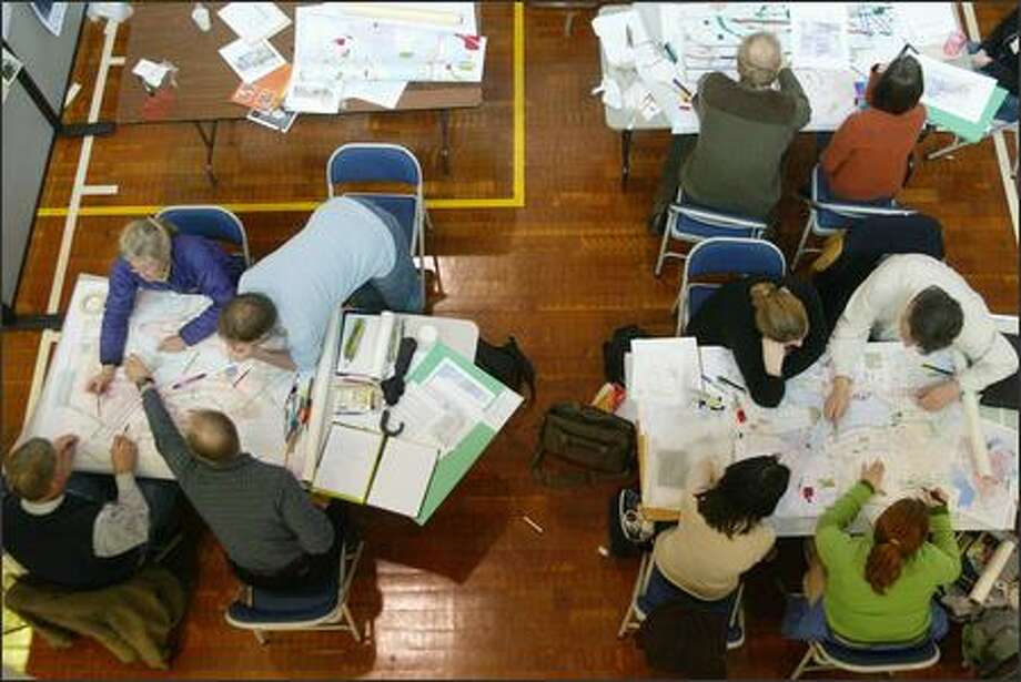 Residents gather at the South Lake Union Armory to plot out Seattle's civic future at the Green Futures Design Charrette. The group in this photo was working on designs for Lake Union. Photo: Paul Joseph Brown/Seattle Post-Intelligencer