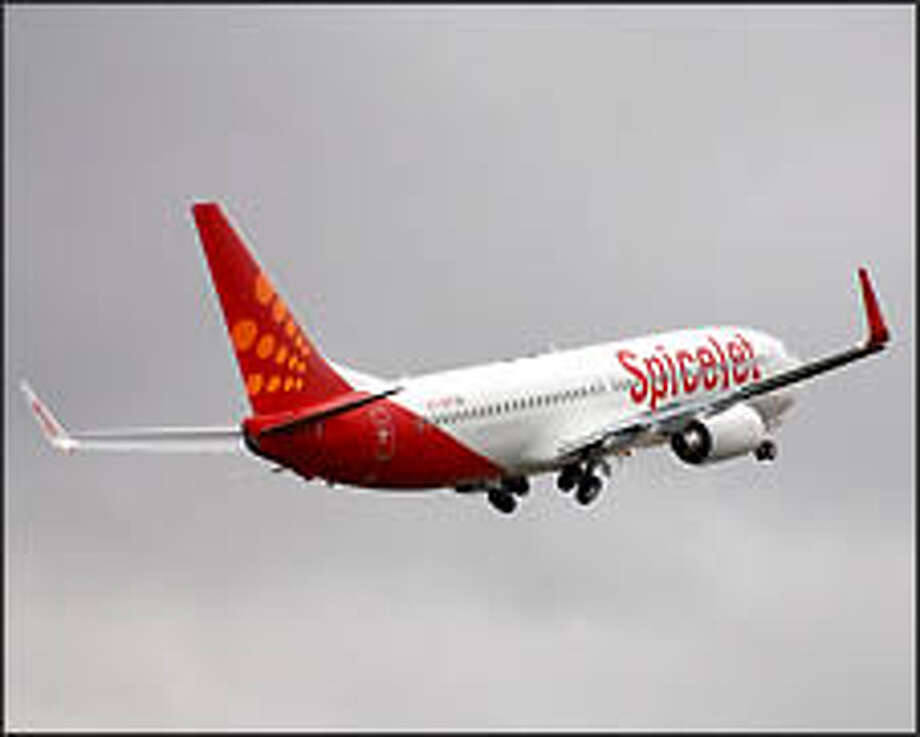 A 737-800 operated by India's SpiceJet takes off from Boeing Field. India's explosion in air travel is being driven by several factors. Photo: The Boeing Co. / The Boeing Company 2006