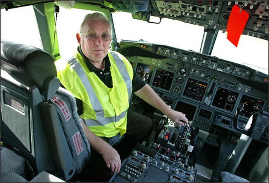 George Cook, seen here in the cockpit of an unfinished 737, has worked on 737s since the first planes rolled down the assembly line. Photo: Gilbert W. Arias/Seattle Post-Intelligencer / Seattle P-I