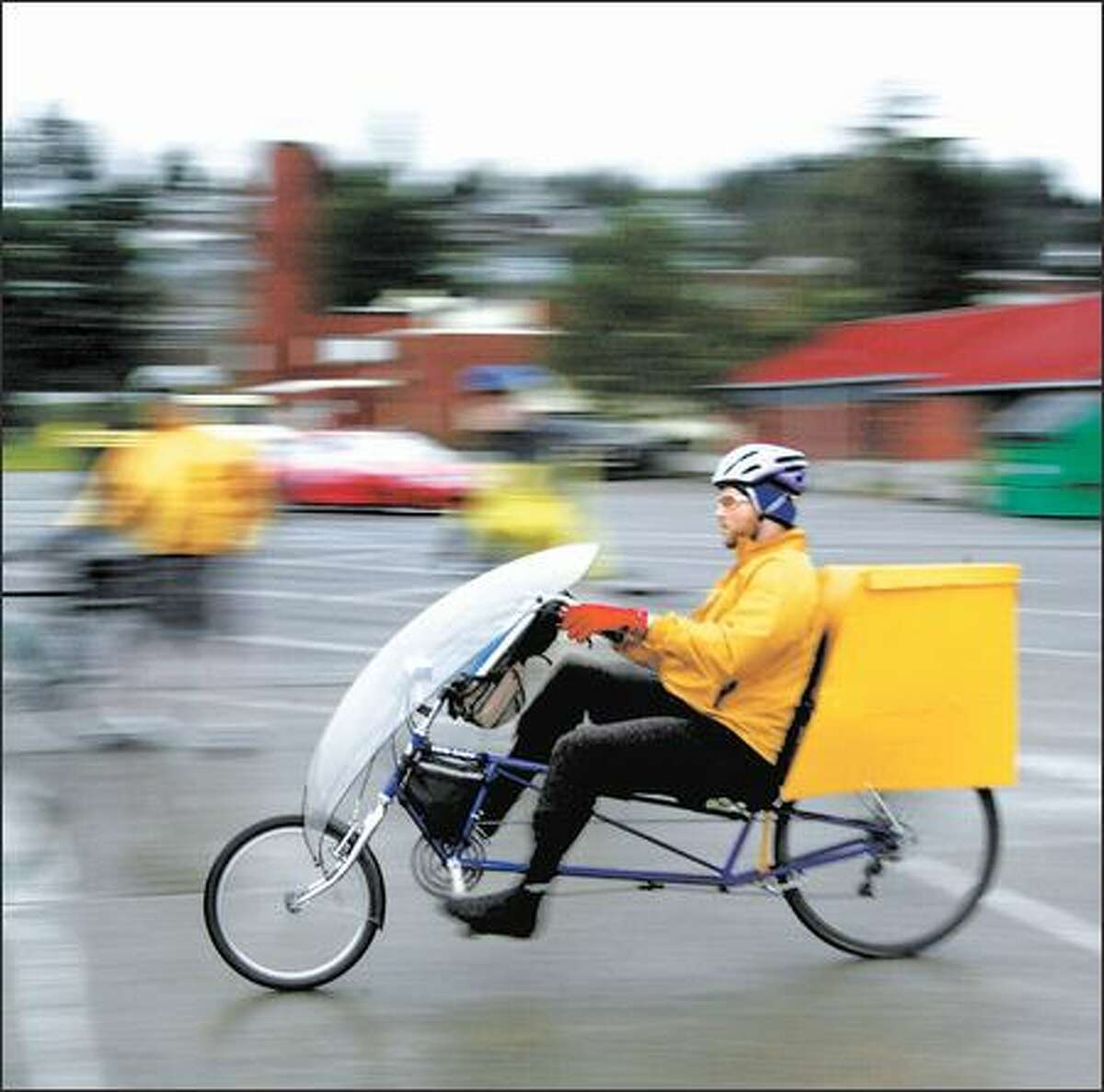 """Wood, riding his recumbent bike, teaches maneuvers to deal with hazards. """"Knowing how to ride effectively and safely, you can avoid most accidents,"""" he says."""