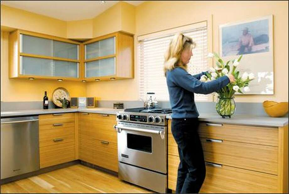Ann Knight, co-owner of Teragren, used bamboo cabinets by Henrybuilt in her home kitchen. Photo: Steve Shelton/Special To The Seattle Post-Intelligencer