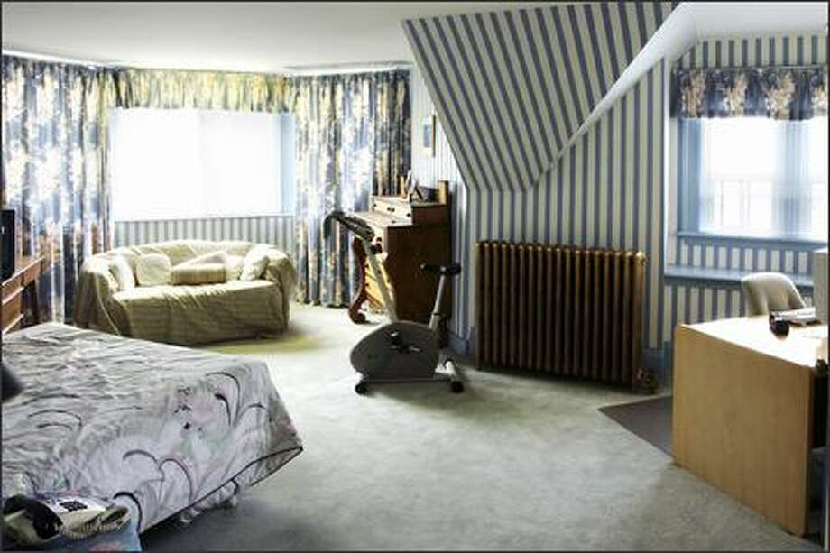 Before: Hypnotic striped wallpaper made the room's angles more awkward. Photo: / HGTV