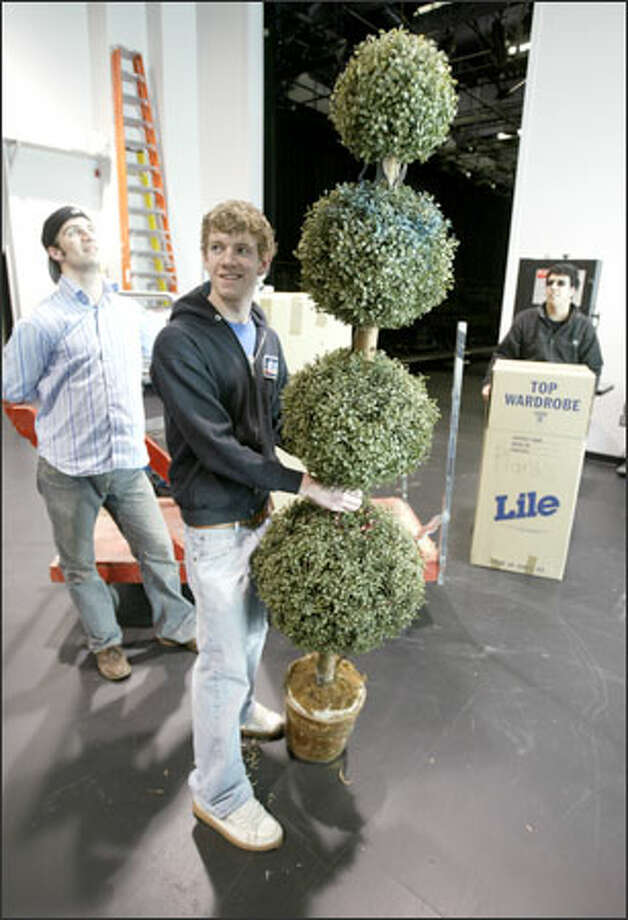From left, theater shop hands Damian Peterson, John Englehardt and Ofer Alves move hundreds of props from storage into the new $6.75 million Lee Center for the Arts at Seattle University. Photo: Mike Urban/Seattle Post-Intelligencer / Seattle Post-Intelligencer