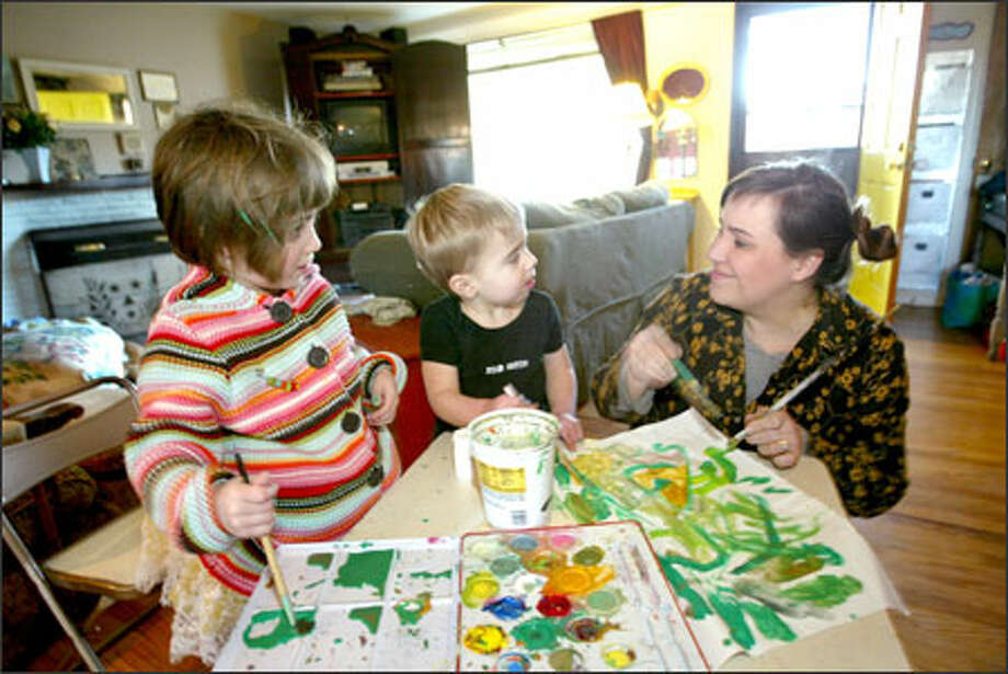 "Trisha Gilmore paints with her son, Beck, 2, and daughter, Flynn, 4, at their West Seattle home. Gilmore recently had to choose which school would be best for Flynn. ""It's huge, your first child going to school. I think that's why the weight is so heavy,"" she says. Photo: Scott Eklund/Seattle Post-Intelligencer / Seattle Post-Intelligencer"