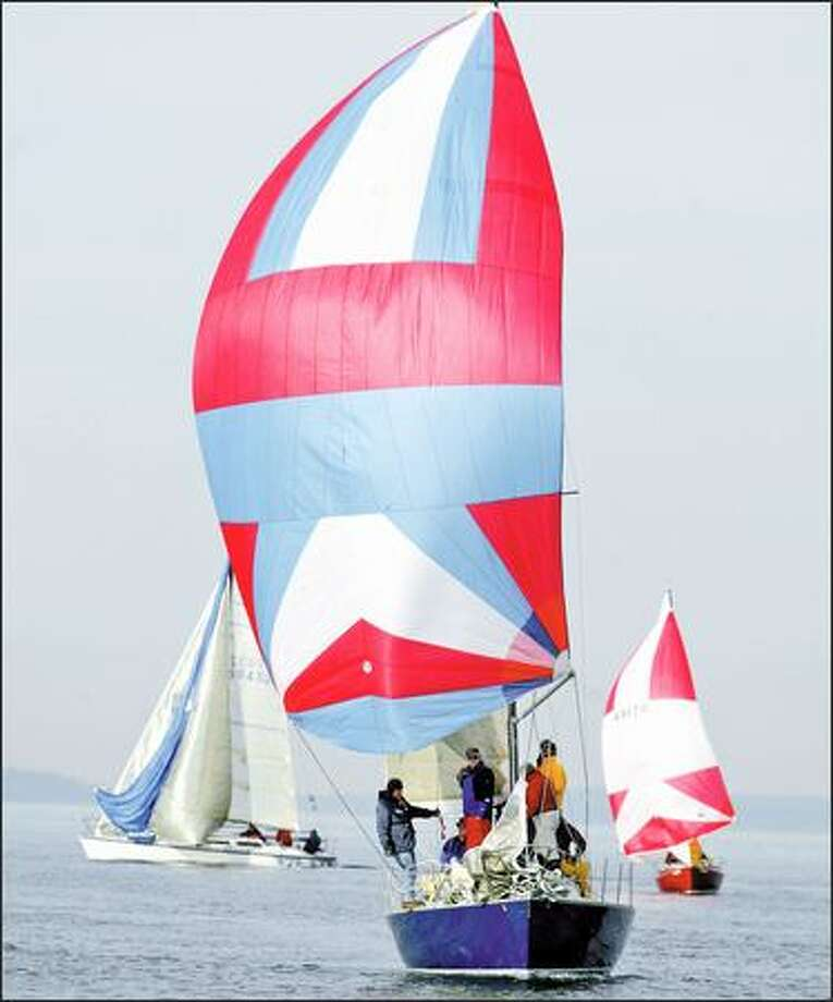 The Last Fling IV, front, with a full spinnaker in low winds, participates in a Snowbird Series race on Puget Sound. Photo: PAUL JOSEPH BROWN/P-I
