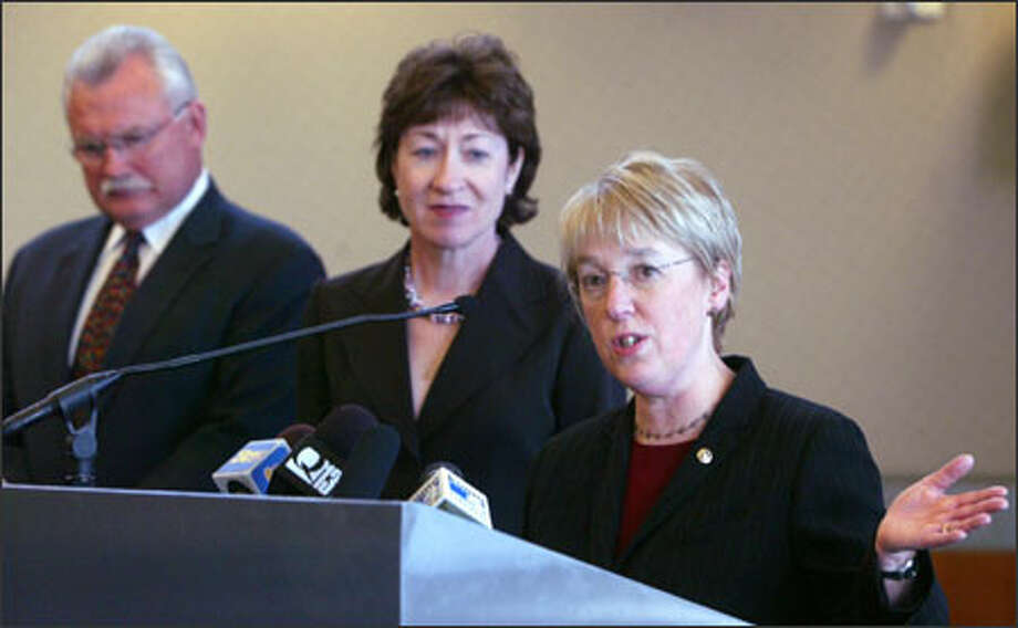 From left, Port of Seattle Chief Executive Mic Dinsmore and Sens. Susan Collins, R-Maine, and Patty Murray, D-Wash., discuss the sale of port operations at a news conference in Seattle Wednesday. Photo: Karen Ducey/Seattle Post-Intelligencer / The Seattle Post-Intelligencer