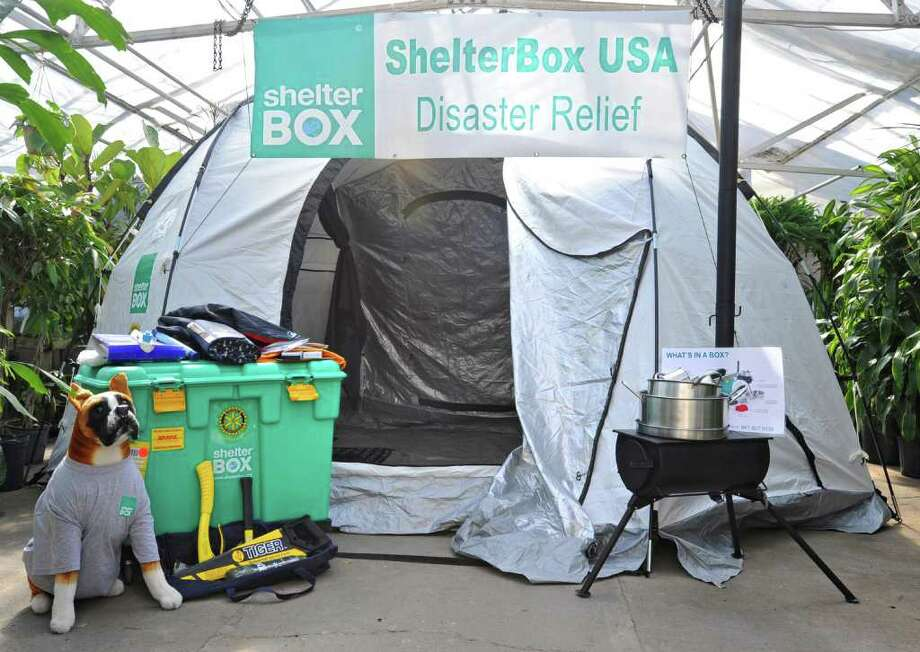 A ShelterBox to aid in the Japan earthquake relief efforts is displayed at Faddegon's Nursery in Latham, NY, on March 18, 2011. The contents of a ShelterBox, self-contained humanitarian aid, can support up to 10 people for six months and includes a tent, wood-burning stoves, pots and utensils. (Lori Van Buren / Times Union) Photo: Lori Van Buren