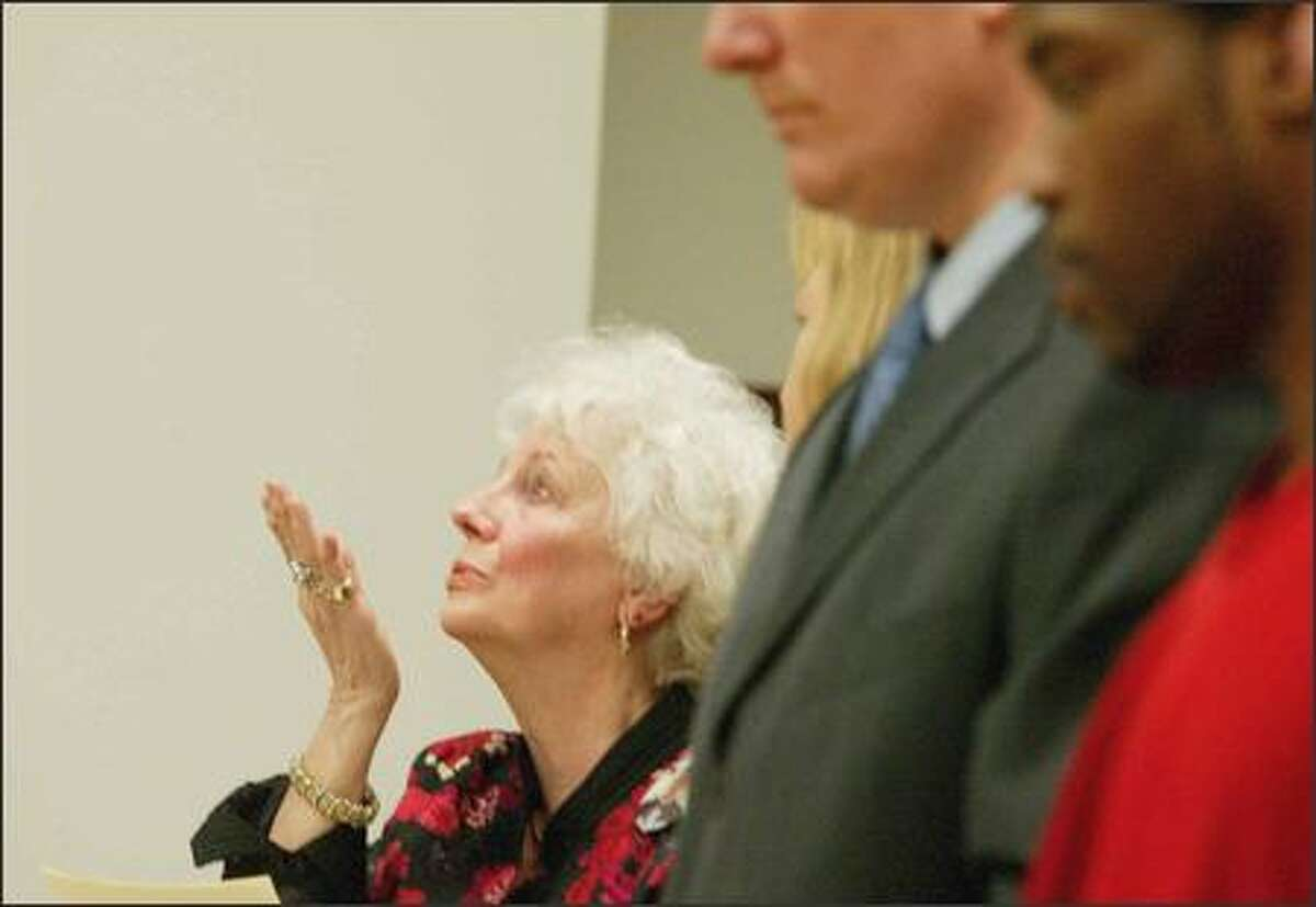 Beverly Schukar blows a kiss to her grandson, Kristopher Kime, after making a statement at a hearing in which Jerell Thomas, right, pleaded guilty in Kime's death.