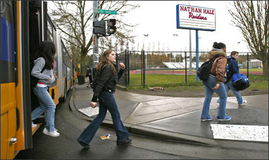 Nathan Hale High School students, including ninth grader Amara Mahoney, center,  disembark from a Metro bus near the school. Photo: Dan DeLong/Seattle Post-Intelligencer