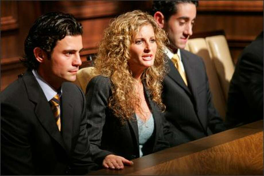 """Summer, center, was the first candidate booted from this season's """"The Apprentice,"""" after repeatedly interrupting Donald Trump while he was actually trying to fire one of her teammates, Tarek, left. Photo: /NBC"""