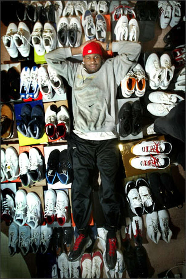 Senior Jamaal Williams is one well-heeled Husky, owning more than 100 pairs of sneakers picked up during his basketball travels Photo: Scott Eklund/Seattle Post-Intelligencer / Seattle Post-Intelligencer