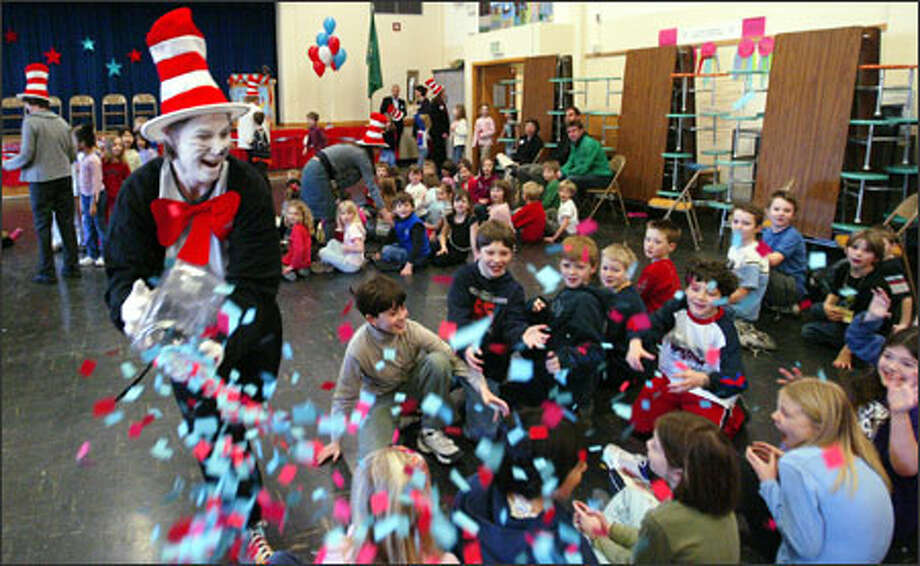 North Beach Elementary in Seattle celebrated the 102nd birthday of Dr. Seuss on Thursday with an appearance by the Cat in the Hat, played by parent Peggy Gupgell. Photo: Paul Joseph Brown/Seattle Post-Intelligencer