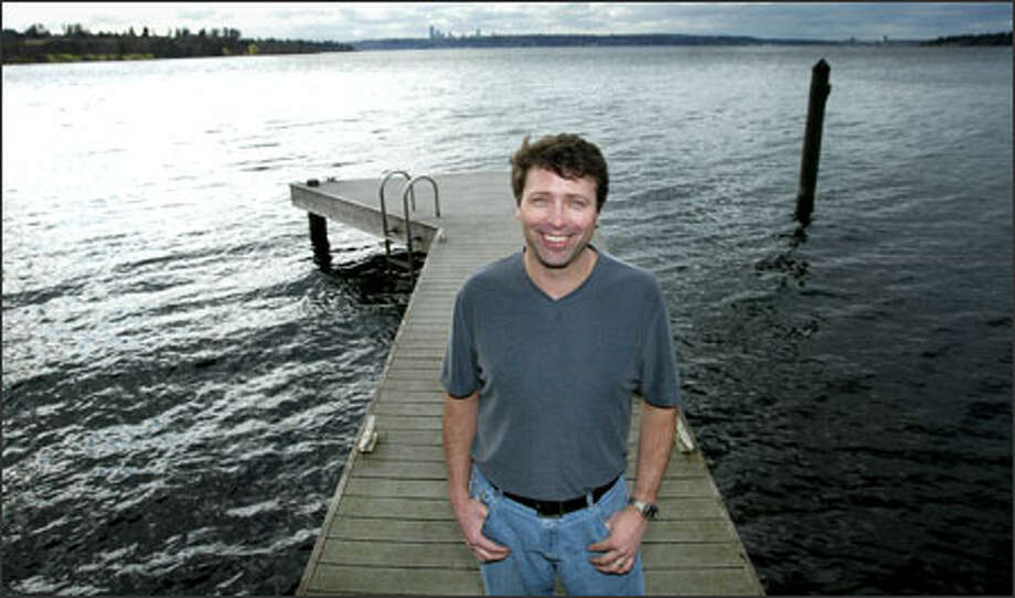 Bill Baxter, a co-founder of the four-person, self-funded startup Snaptune, stands on the dock of his home in Bellevue. Photo: Paul Joseph Brown/Seattle Post-Intelligencer