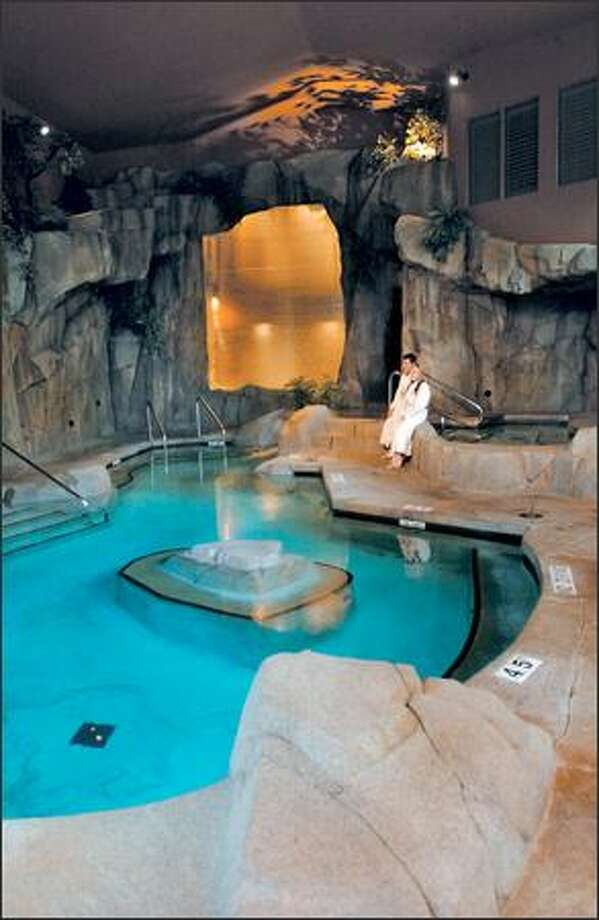 Rocklike outcroppings with a waterfall provide a backdrop for the Grotto Spa pool at Tigh-Na-Mara. Photo: JEFF LARSEN/P-I