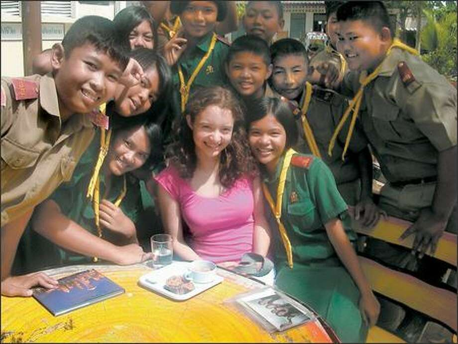 Maya Sugarman, surrounded by Thai students she helped teach English last summer in Samut Sakhon, a few hours from Bangkok. Photo: /