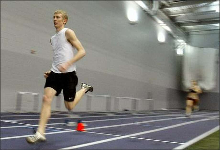 UW sophomore Austin Abbott is just the third Husky runner to ever register a sub-four-minute mile. Photo: Meryl Schenker/Seattle Post-Intelligencer