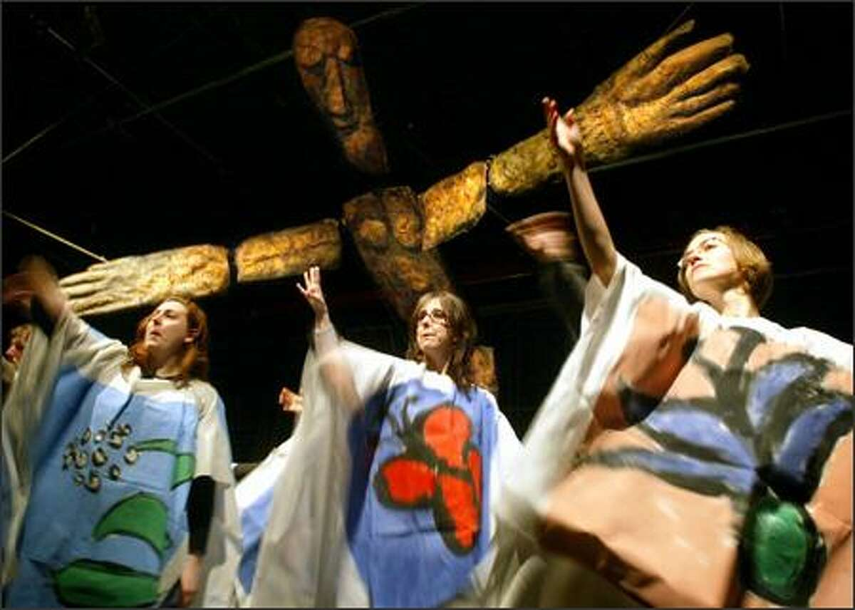"""From left, Julia Sirna-Frest, Lisa Reynolds and Sabine Foster of Seattle work with Bread and Puppet during a rehearsal for """"Daughter Courage,"""" playing at Consolidated Works."""
